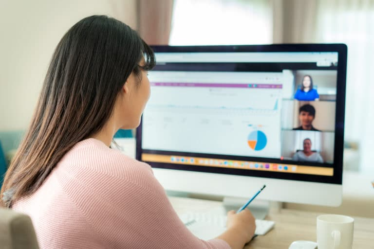 Woman working from home participating in a video conference